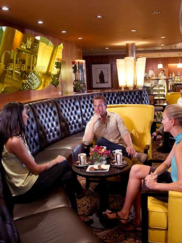 People chatting at Cafe al Bacion on-board Celebrity Infinity